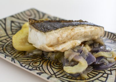 Low temperature sea bass on tubers in its juice