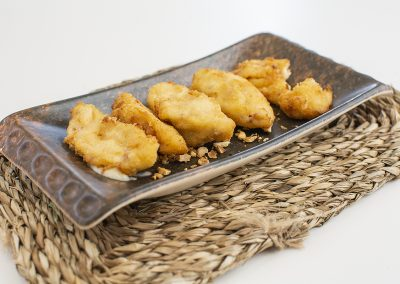 Homemade ham croquettes (Crispy, bite-size logs of smooth ground ham coated in breadcrumbs)